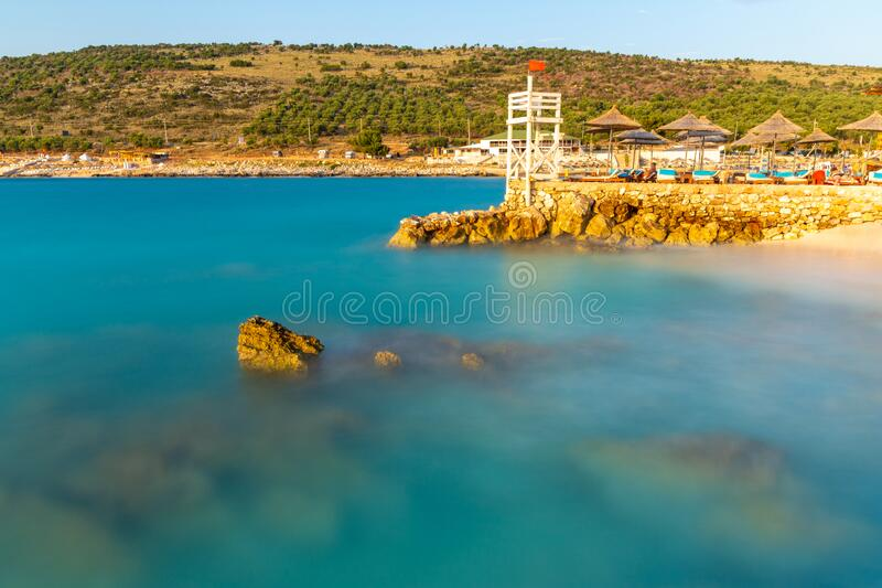 Blue sea during long time exposure in Ksamil in Albania stock photography