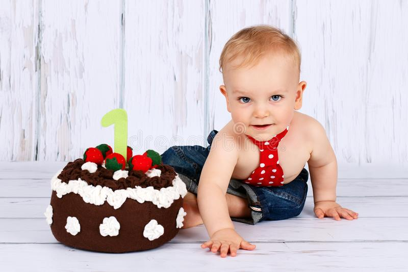 Beautiful baby boy celebrating his first birtday stock image