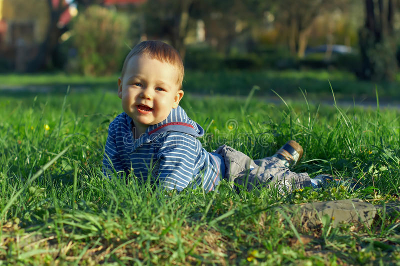 Download Beautiful Baby Boy Lying On Green Grass Stock Image - Image: 24670417