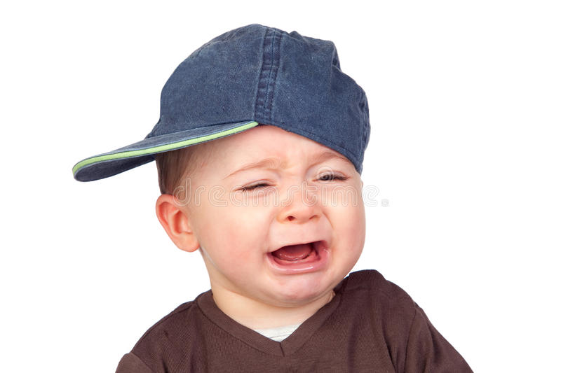 Beautiful baby crying with a cap royalty free stock photography