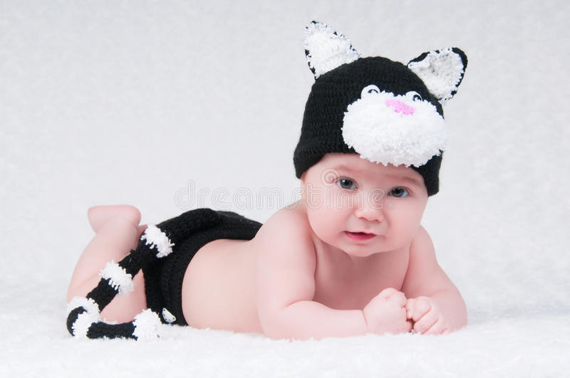 Beautiful baby in funny costume with cat ears and a tail. royalty free stock photography