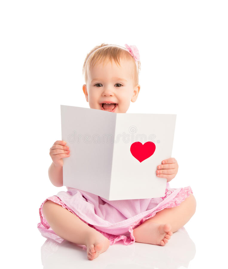 Beautiful baby girl with cute valentine postcard with a red hear. T isolated on white background royalty free stock photography