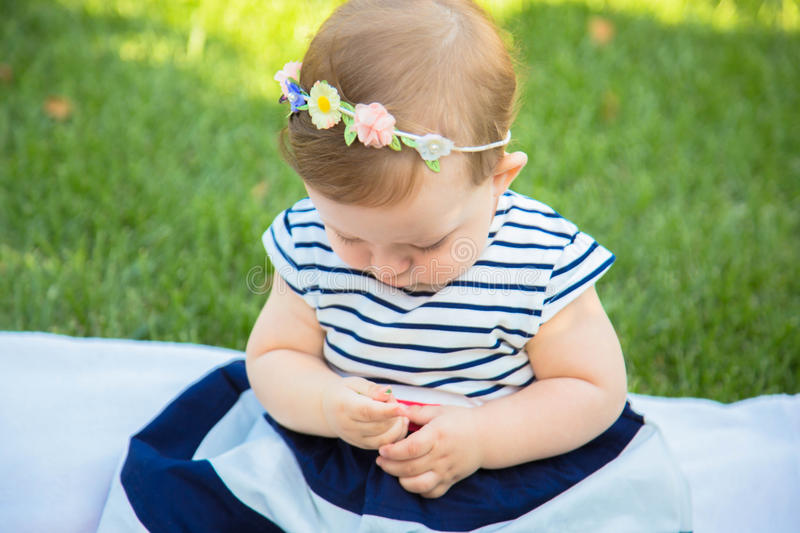 Beautiful baby girl on the green grass. Happy childhood royalty free stock photos