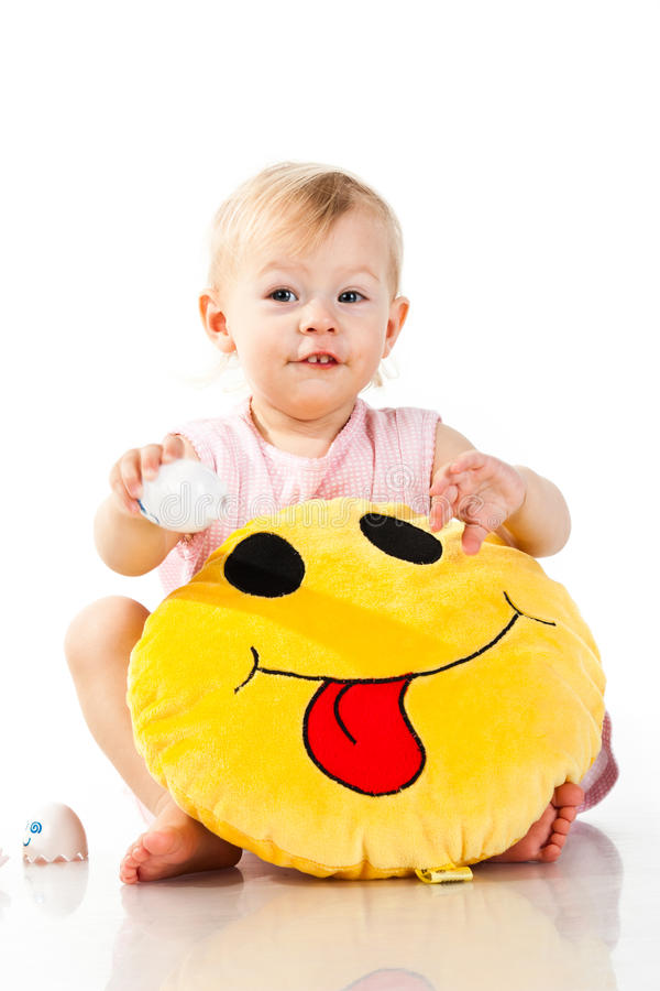 Beautiful baby girl holding a pillow stock photos