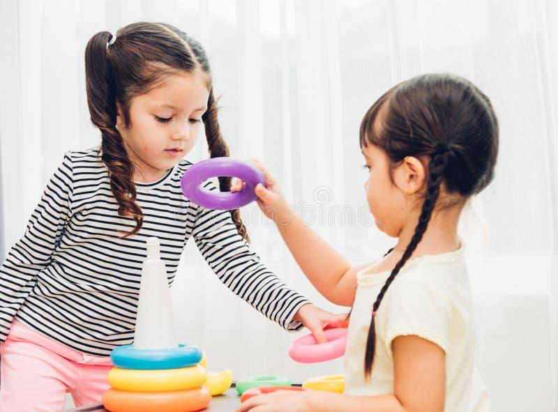 Beautiful baby girl kindergarten play loop toy education royalty free stock photo