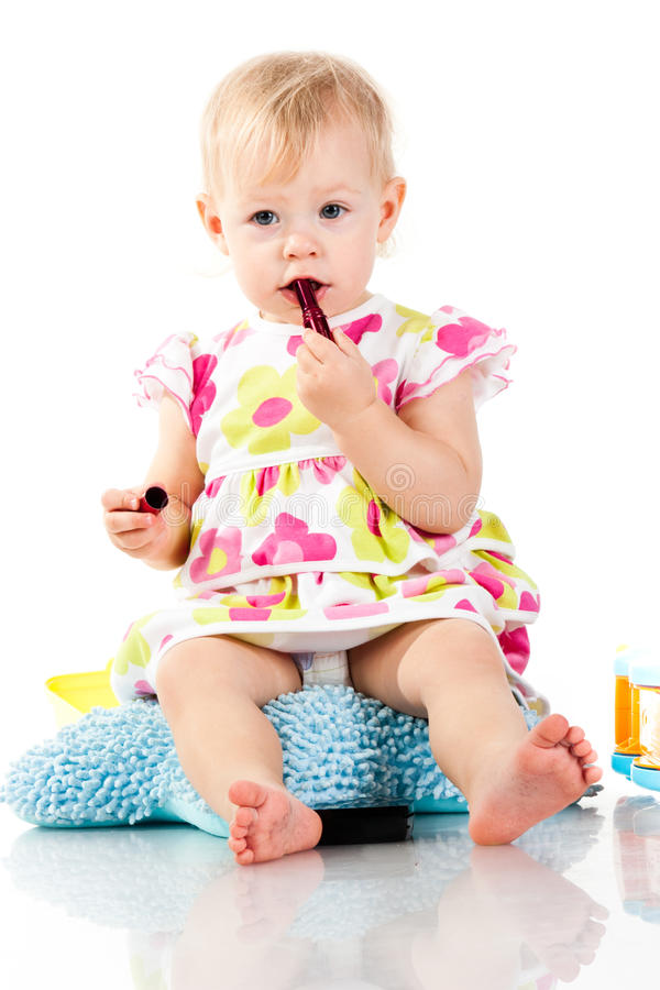 Beautiful baby girl with lipstick royalty free stock photography
