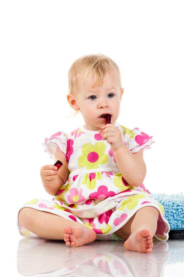 Beautiful baby girl with lipstick royalty free stock image