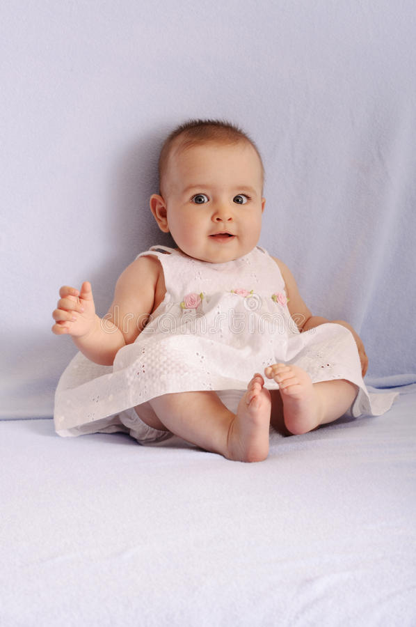 Beautiful baby girl making funny face royalty free stock photos
