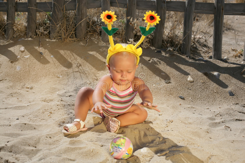 Download Beautiful Baby Girl Playing On The Beach Stock Photo - Image: 4465288