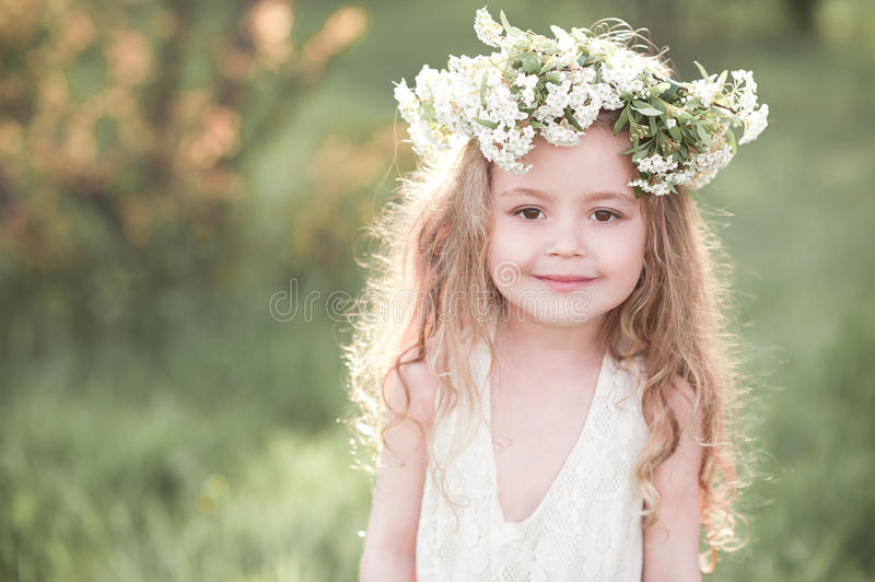 Beautiful baby girl posing outdoors over nature background stock image
