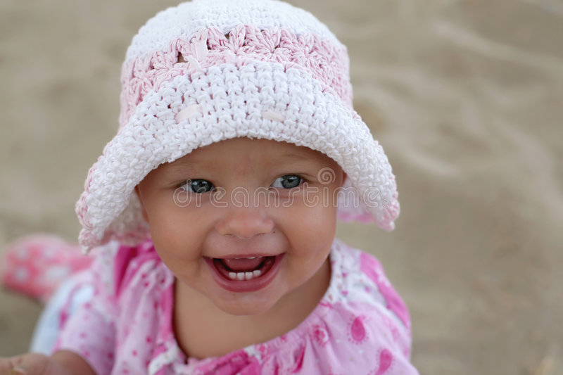 Beautiful Baby Girl Smiling. On the Beach royalty free stock photos