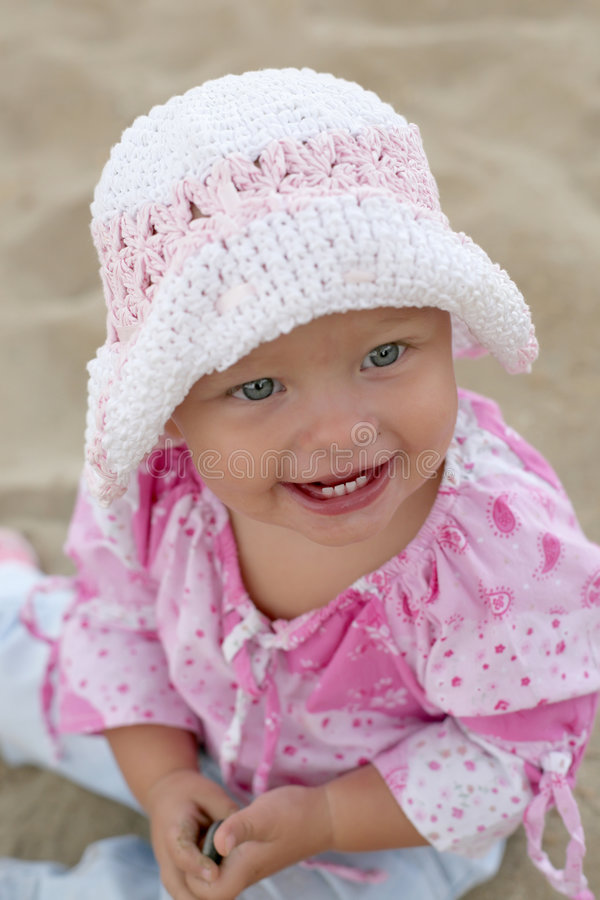 Beautiful Baby Girl Smiling. On the Beach stock images