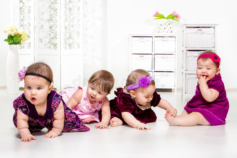 Girls group in festive dresses. Beautiful baby girls group in festive dresses royalty free stock photos