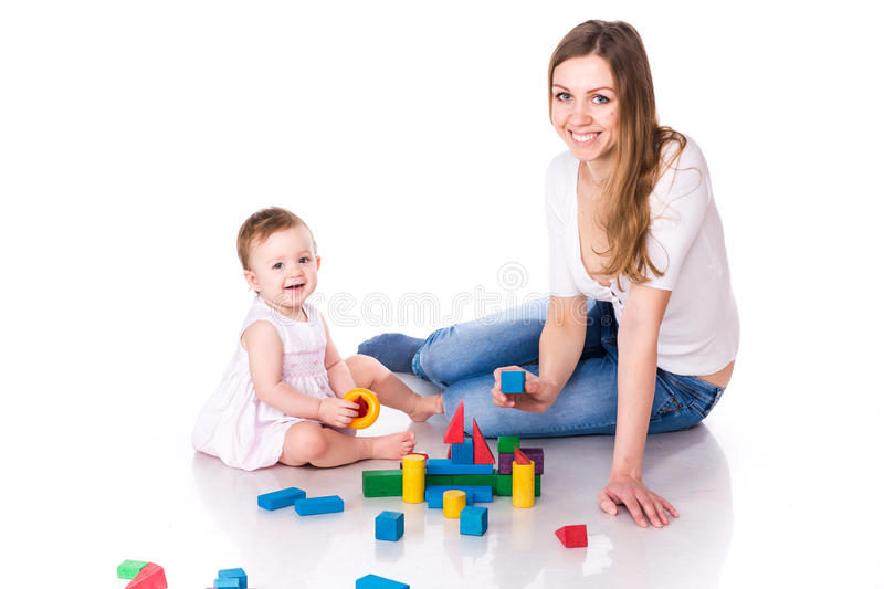 Beautiful baby with mother building with cubes royalty free stock photos