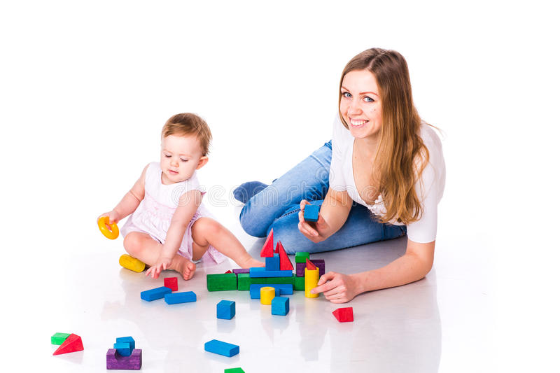 Beautiful baby with mother building with cubes royalty free stock photography