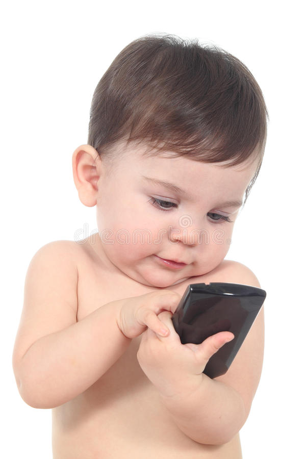 Beautiful baby playing and touching a mobile phone stock images