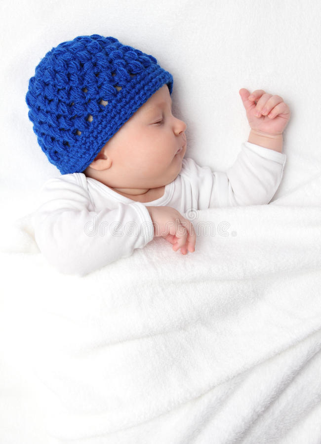 Beautiful baby sleeping on bed stock images