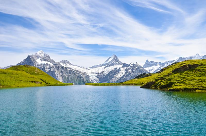 Beautiful Bachalpsee in the Swiss Alps photographed with famous mountain peaks Eiger, Jungfrau, and Monch. Lake and Alpine stock images