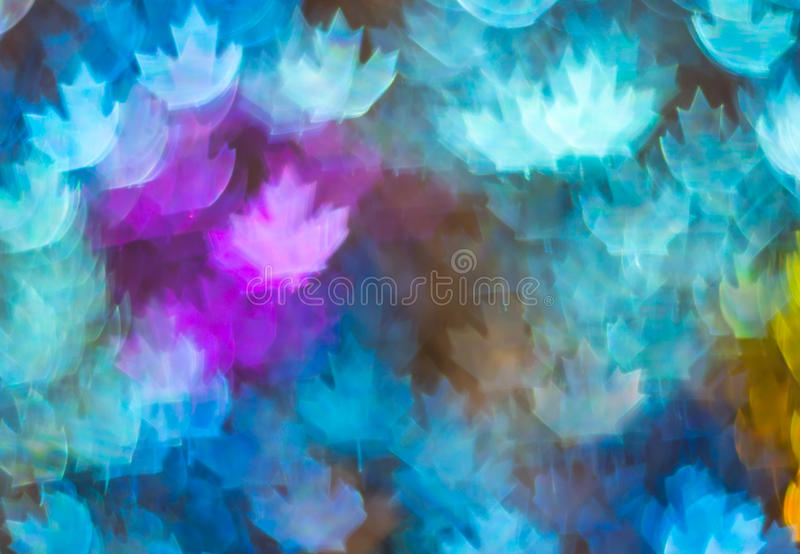 Beautiful background with different colored leaf, abstract background, leaf shapes on black background. Blurry stock photos