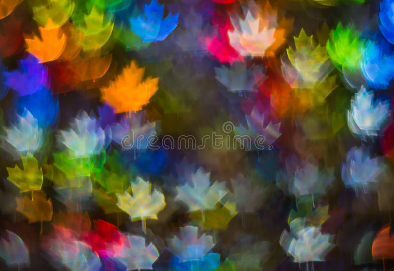 Beautiful background with different colored leaf, abstract background, leaf shapes on black background. Blurry royalty free stock images