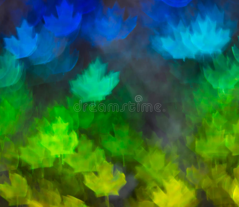 Beautiful background with different colored leaf, abstract background, leaf shapes on black background. Blurry royalty free stock photo