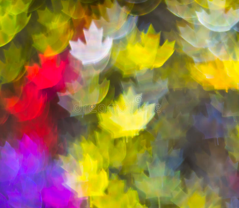 Beautiful background with different colored leaf, abstract background, leaf shapes on black background. Blurry royalty free stock photography