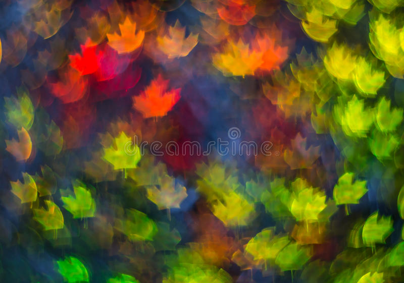 Beautiful background with different colored leaf, abstract background, leaf shapes on black background. Blurry royalty free stock image
