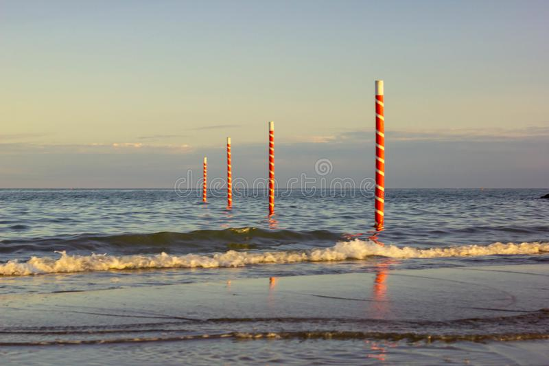 Beautiful background with images of a wonderful beach and a beautiful sea in Italy, Jesolo beach in venice in veneto. attracts man. Y tourists and would be royalty free stock photography