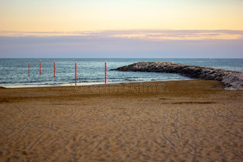 Beautiful background with images of a wonderful beach and a beautiful sea in Italy, Jesolo beach in venice in veneto. attracts man. Y tourists and would be royalty free stock photos