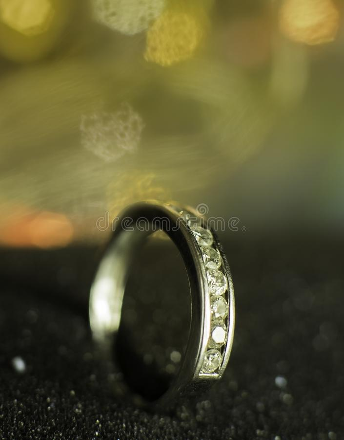 A diamond ring with small diamonds. With beautiful background, micro photography for a diamond ring, which inlaid by small diamonds royalty free stock photography