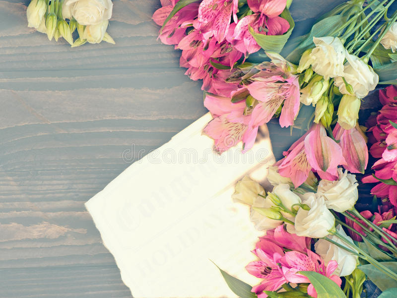 Beautiful background of red and pink Alstroemeria and white eustoma flowers on wooden background. Tinted Windows. Copy space. royalty free stock image