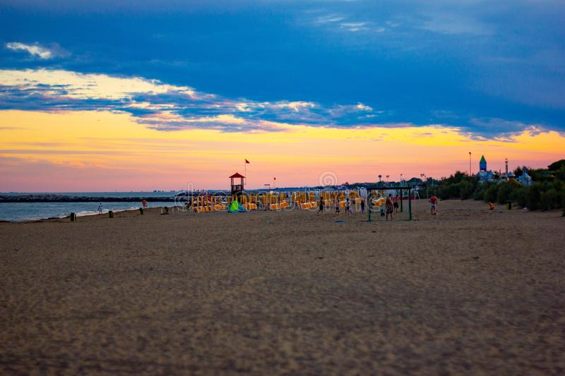 Beautiful background. sunset on the beaches of Jesolo, a town by now super organized to make its tourists happy. Beautiful background. sunset on the beaches of royalty free stock image