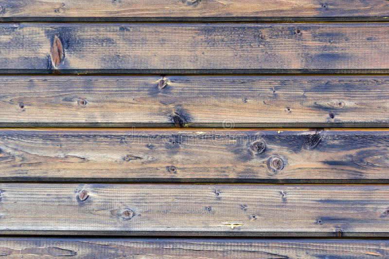 Beautiful background with the texture of wooden boards. A wall made of horizontal slats. An unusual photo royalty free stock image