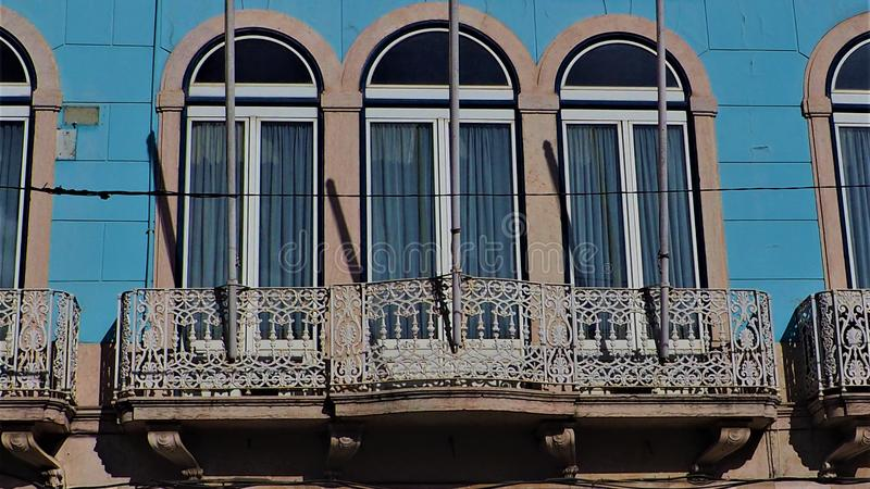A beautiful balcony in a blue building. In lisbon royalty free stock image