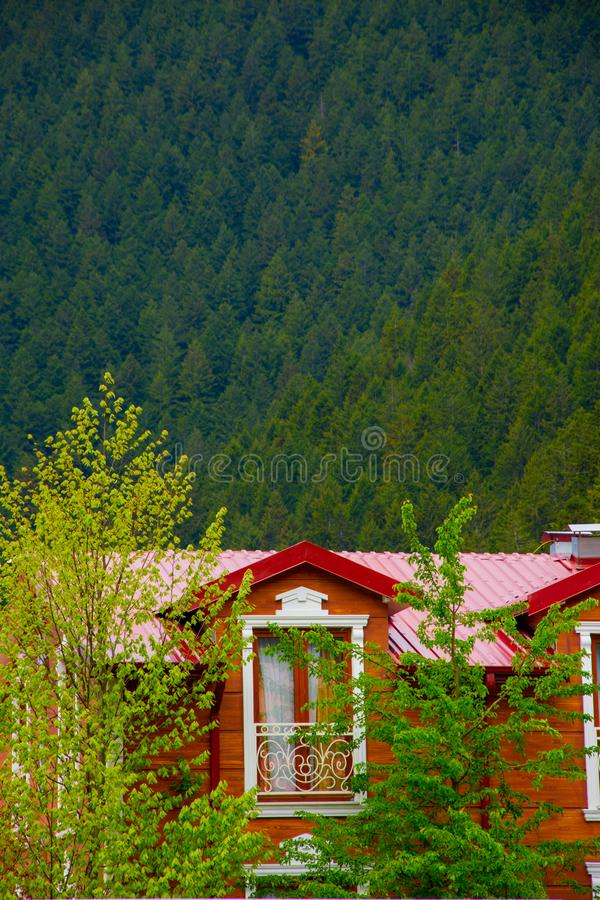Beautiful balcony of the small wooden house in the forest. In Uzungol stock photos