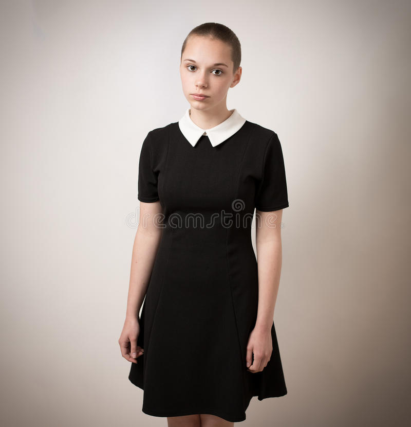Beautiful Bald Shaven Young Teenage Girl In Black Dress royalty free stock photos