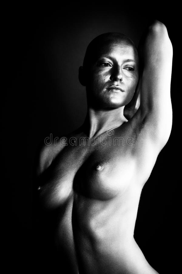 Beautiful bald woman. On black background royalty free stock images
