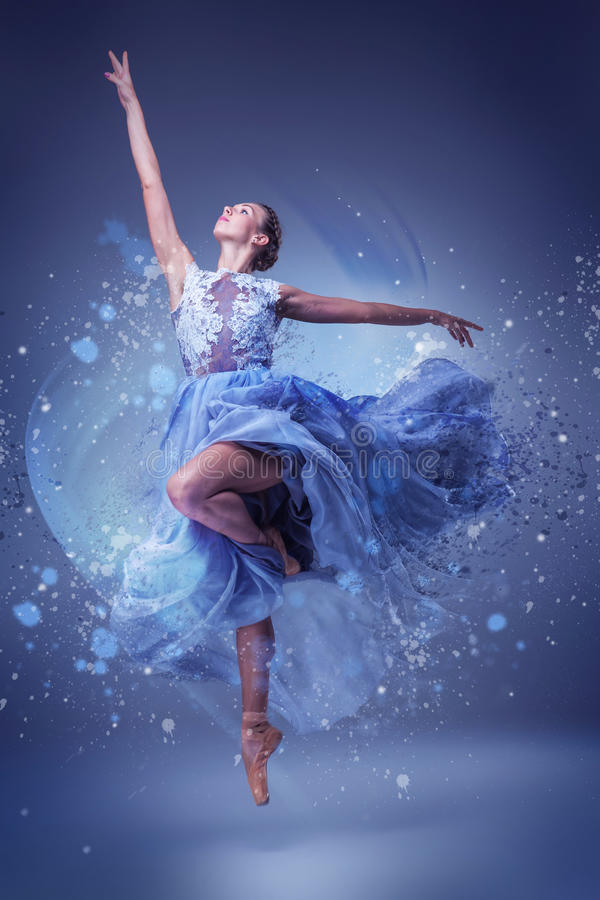 The beautiful ballerina dancing in blue long dress. The beautiful ballerina dancing in long blue dress on blue background stock images