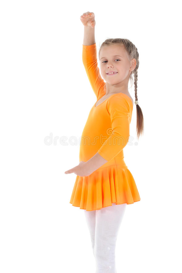 Beautiful ballerina dancing in an orange dress. stock photo