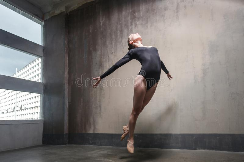 Beautiful ballerina jumping, soaring in the air and fly stock image