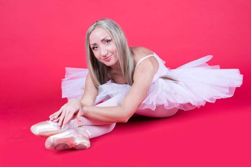 Beautiful ballerina resting after training stock image