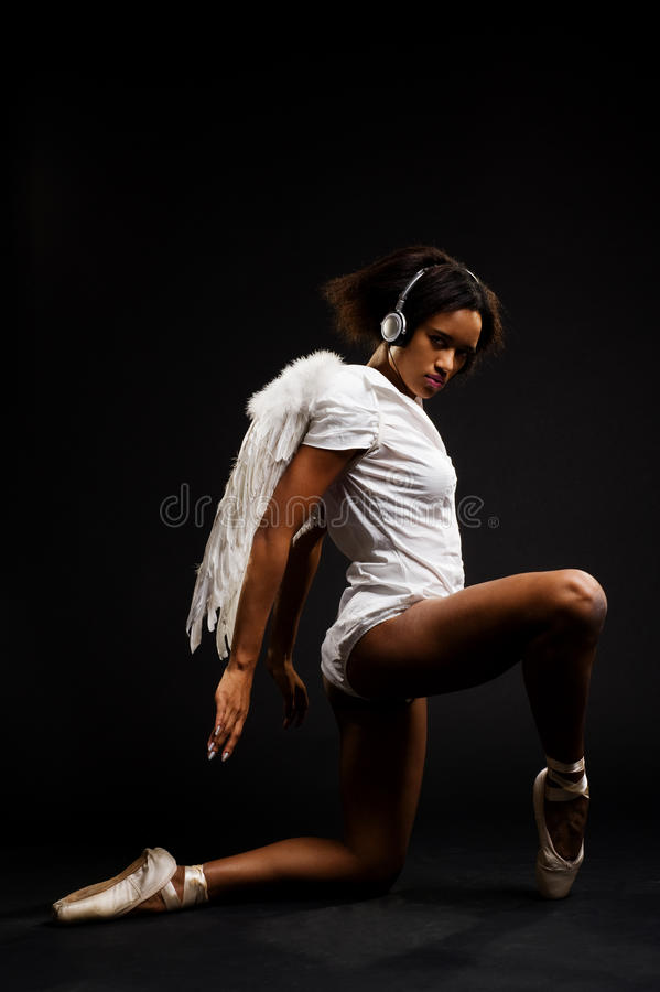 Beautiful ballerina with white wings royalty free stock photos