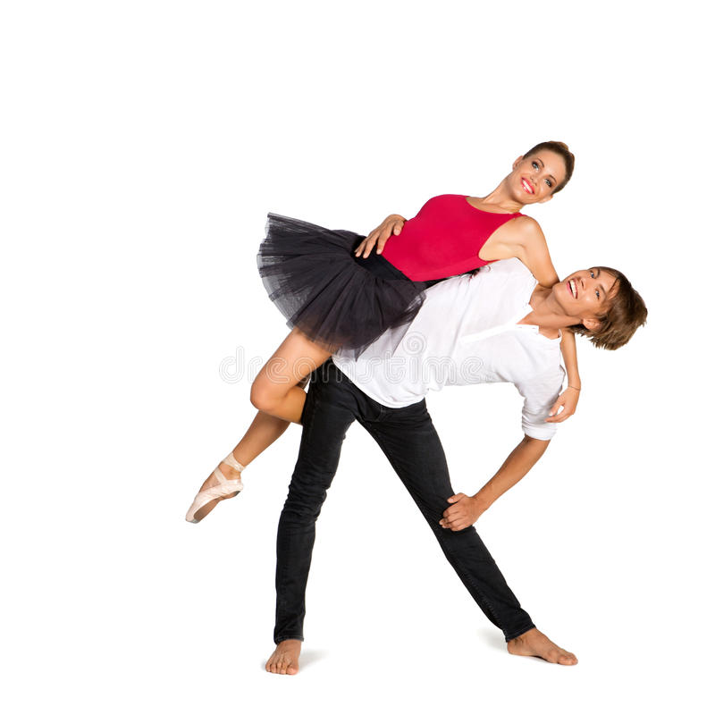 Beautiful ballet couple. Beautiful young couple dancing ballet over white background royalty free stock images