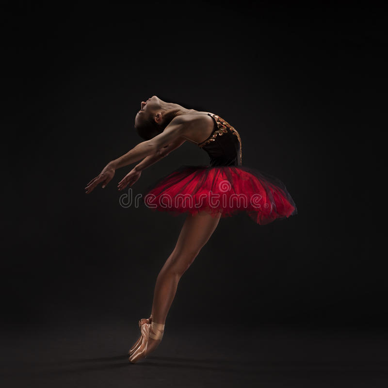 Beautiful ballet dancer on black royalty free stock photos