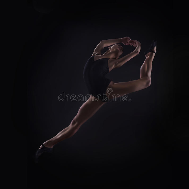 Beautiful ballet dancer jumping royalty free stock photos