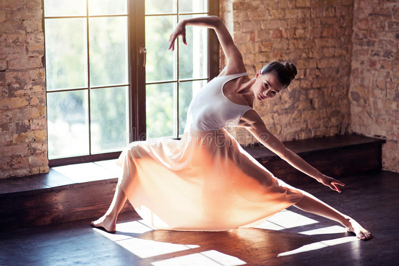 Beautiful ballet dancer training in a gym royalty free stock photos
