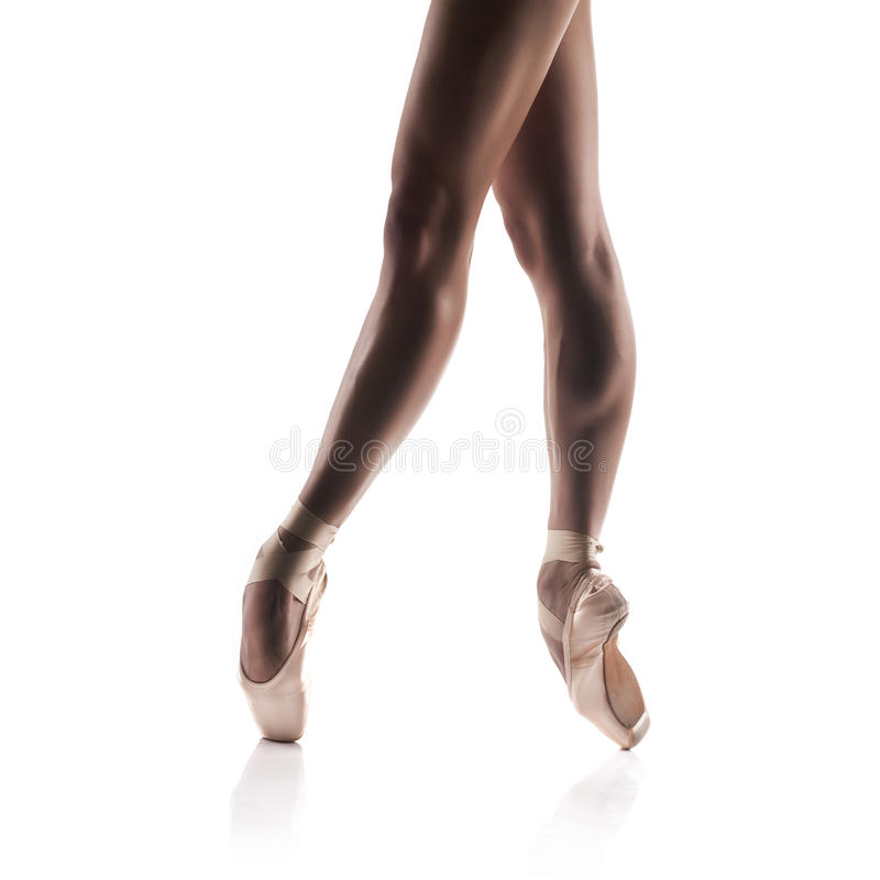 Beautiful ballet dancers legs on white stock images