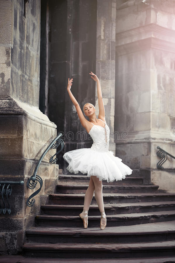 Beautiful ballet woman on stairs royalty free stock photos
