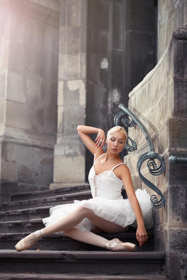 Beautiful ballet woman on stairs stock photo