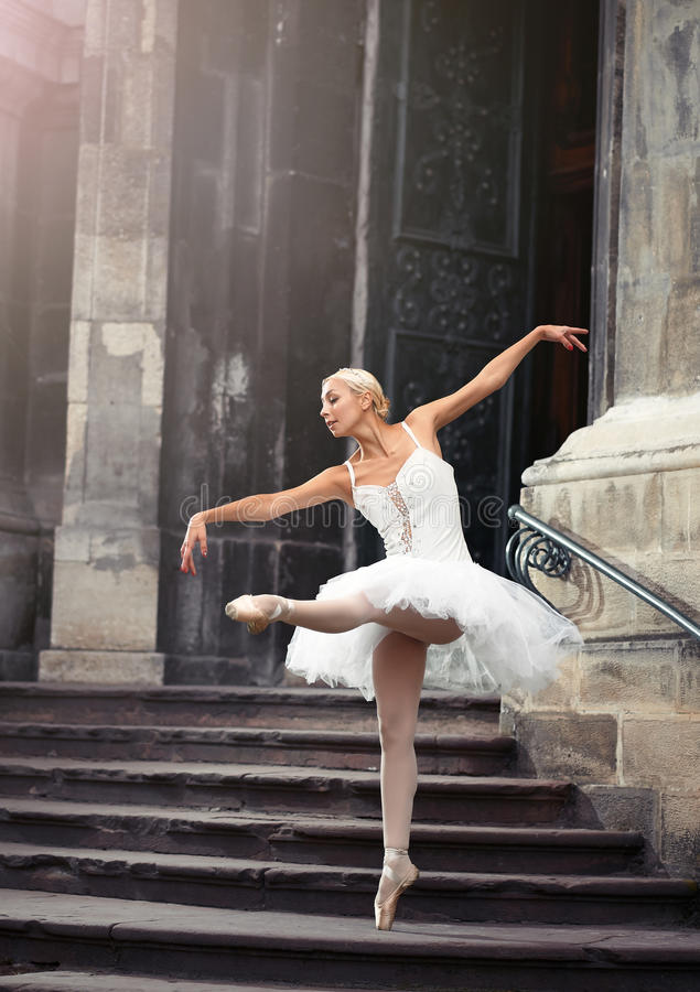 Beautiful ballet woman on stairs royalty free stock images